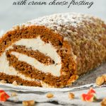 A pumpkin and walnut roll cake filled with cream cheese.