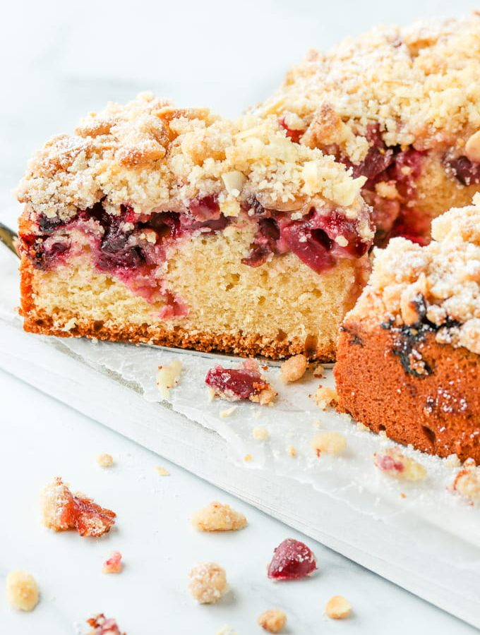 Serving a slice of cherry crumb cake