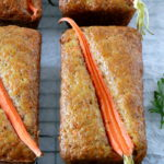 Baked carrot loaves topped with a carrot