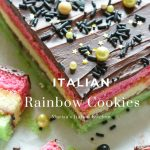 Layers of pink, yellow and green cake-like cookies with jam.