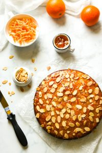 Orange marmalade cake with almonds on top.