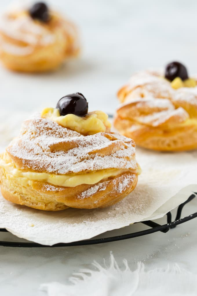 Oven baked Zeppole di San Giuseppe filled with custard.