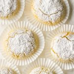 Ricciarelli cookies on white candy wrappers.